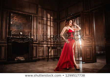 Stockfoto: Elegant Stunning Woman With Red Hair On Chair