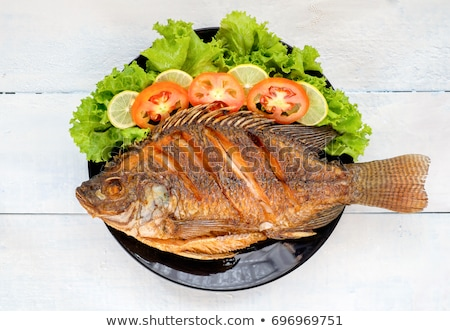 жареный · рыбы · лоток · таблице · фон · ресторан - Сток-фото © racoolstudio