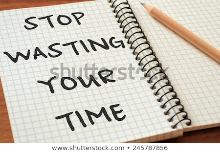 Stop wasting your time text on notepad  Stock photo © fuzzbones0