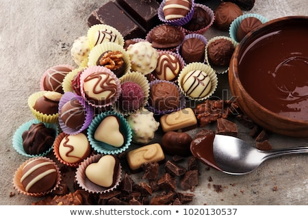finom · csokoládé · háttér · cukorka · fekete · sötét - stock fotó © supertrooper