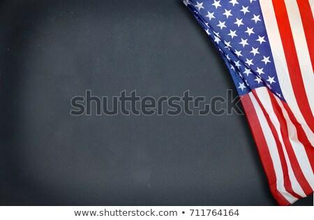 close up of school blackboard on american flag stock photo © dolgachov