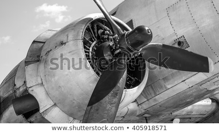 A vintage propeller-powered aircraft in the sky Stock photo © bluering