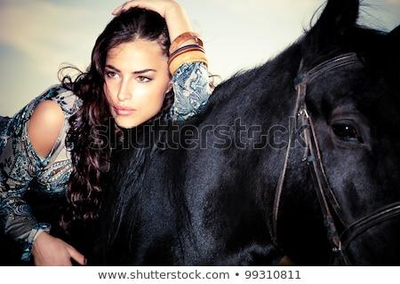 portrait of the cute brunette woman riding a horse stock photo © konradbak
