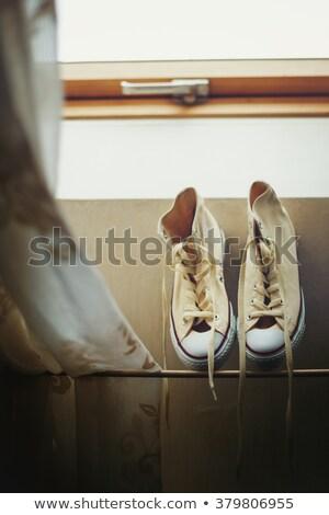 Stok fotoğraf: Beige Sneakers Getting Dried Near Window