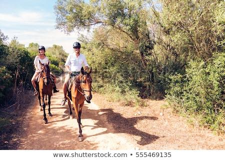 Twee mensen paardrijden paardenrug buitenshuis voorjaar meisje Stockfoto © OleksandrO