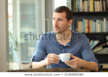 Wman with cup of coffee sitting and dreaming at home stock photo © deandrobot