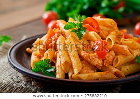 Plate of penne pasta with tomato sauce stock photo © bluering