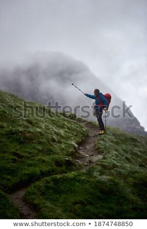 Férfi turista áll domboldal hegyek európai Stock fotó © Kotenko