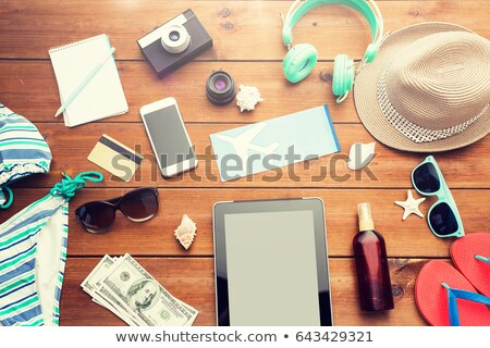 tablet pc, smartphone, airplane ticket and camera Stock photo © dolgachov