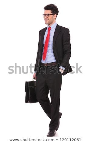 Felice giovani imprenditore piedi inoltrare bianco Foto d'archivio © feedough
