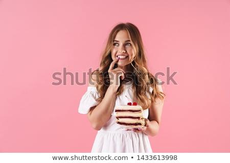 Fiatal nő lány torta izolált fehér mosoly Stock fotó © Sibstock
