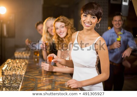 Portrait of happy woman having tequila shot Stock photo © wavebreak_media