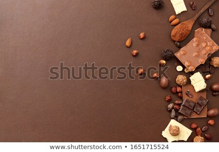 Almond nuts on dark background directly above copy space flat lay Stock photo © yelenayemchuk
