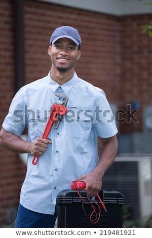Black Mechanic or Plumber Handyman Stock photo © Krisdog