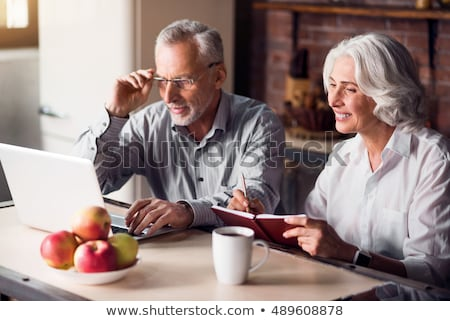 Older man and woman looking at laptop Stock photo © IS2