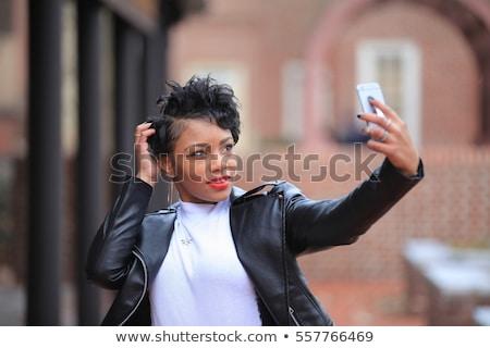 Africano americano menina jaqueta de couro belo elegante óculos de sol Foto stock © LightFieldStudios