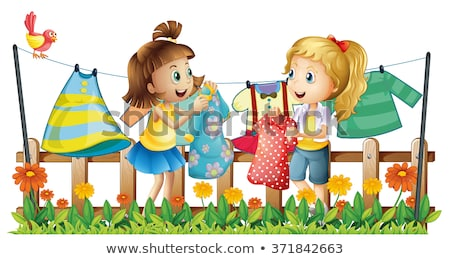young girl hanging out clothes in garden Stock photo © IS2