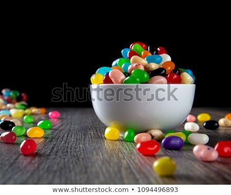 Zselés bab édes színes cukorkák fehér tál Stock fotó © DenisMArt