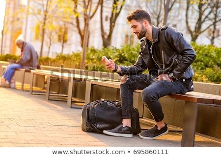 Homem jaqueta de couro telefone móvel moderno tecnologia Foto stock © stevanovicigor