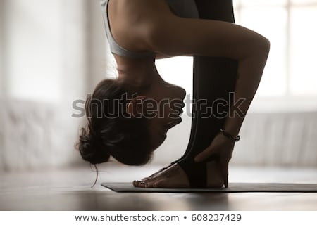 close up of woman in black sportswear posing Stock photo © dolgachov