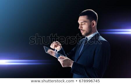 Empresário terno preto laser luz negócio Foto stock © dolgachov