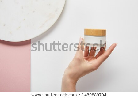 Woman holding glass marbles Stock photo © IS2