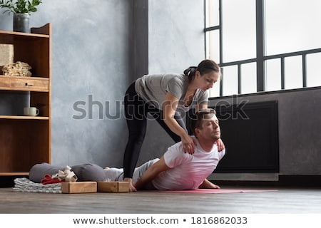 a personal trainer helping a woman in an exercise lesson stock photo © is2
