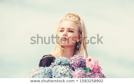 Delicate blonde girl in blooming garden. Stock photo © NeonShot