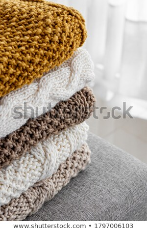 stack of cozy knitted sweaters stock photo © lana_m