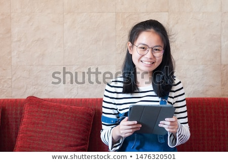 asian student girl with tablet pc learning at home stock photo © dolgachov
