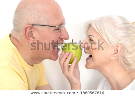 Dentures biting an apple Stock photo © boggy