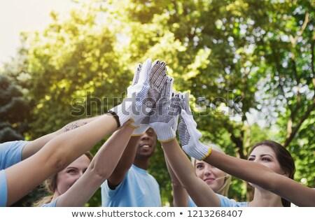 組 志願者 高五 公園 志願 商業照片 © dolgachov