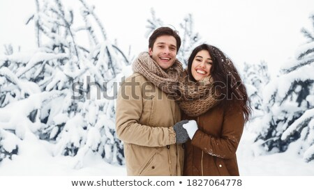 Standiing among the snow covered pine tree forests Stock photo © lovleah
