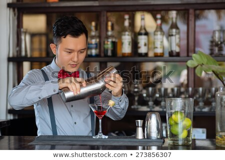 young man with red cocktail glass stock photo © kzenon