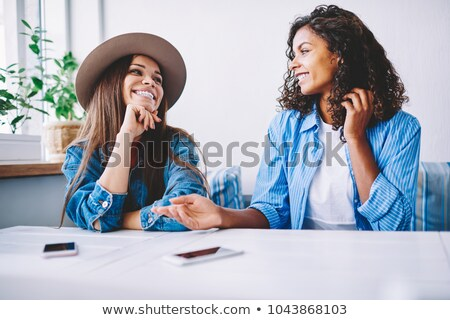 image of caucasian woman 20s wearing casual clothing laughing s stock photo © deandrobot