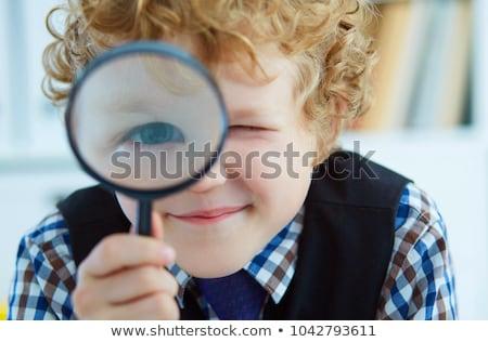 Dziecko chłopca lupą sprawdzać ilustracja mały Zdjęcia stock © lenm