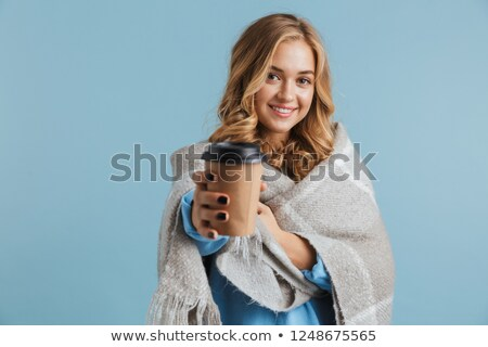 image of european woman 20s wrapped in blanket holding takeaway stock photo © deandrobot