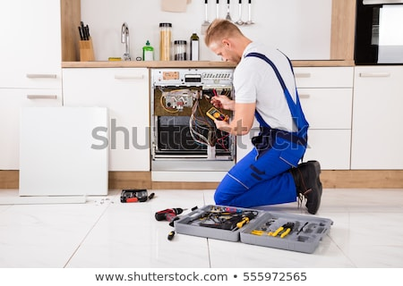 Repairman Fixing Dishwasher With Digital Multimeter Stock photo © AndreyPopov