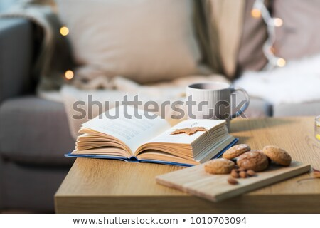 Stock photo: book with autumn leaf, cookies and tea on table