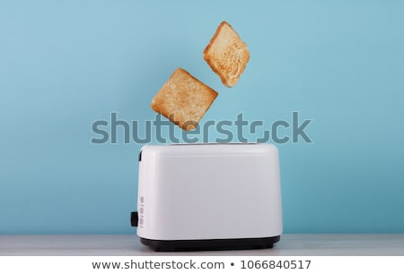 Electric toaster with slice of toasted bread Stock photo © jossdiim