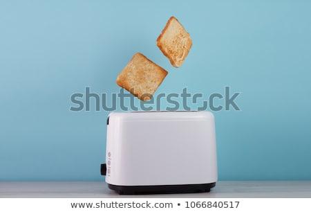 Elektrik ekmek kızartma makinesi dilim tost ekmek fincan Stok fotoğraf © jossdiim