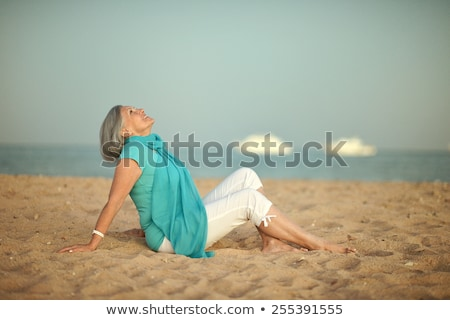 Happy suntanned woman by ocean summer holiday recreation Stock photo © lovleah
