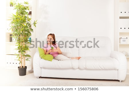 A nine years girl lay on the sofa Stock photo © Lopolo