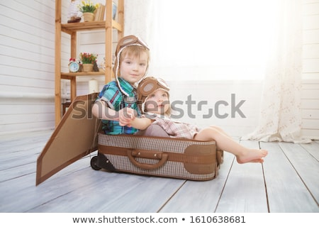 Two little girls are playing at home to travelers wearing vintag Stock photo © dashapetrenko