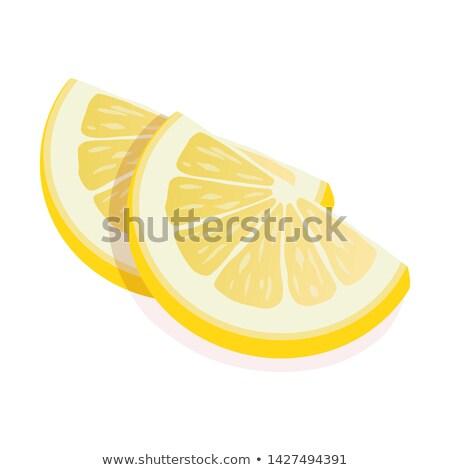 Two ripe slices of yellow lemon citrus fruit stand isolated on white background. Lemon citrus fruit, Stock photo © MarySan