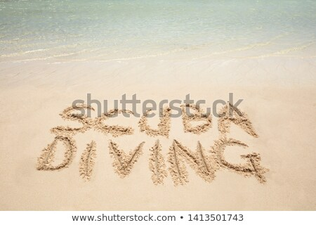 Scuba Diving Text Written On Sandy Beach Stock photo © AndreyPopov