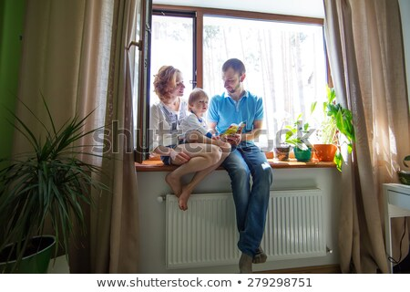 a young family with a boy son in the window of the house stock photo © rogistok