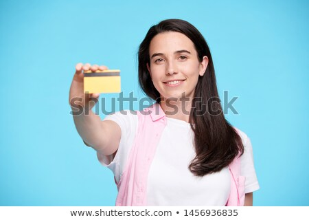 Happy young buyer or shopaholic showing you plastic credit card Stock photo © pressmaster