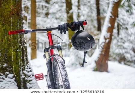 Stock photo: Bike helmet hangs from the handlebars of a bicycle