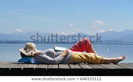 senior · vrouw · lezing · boek · zomer · park - stockfoto © dolgachov